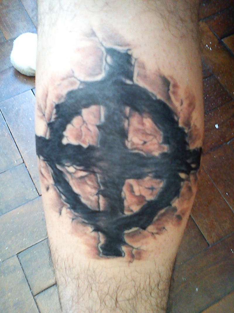 Celtic cross tattoo on skin 3