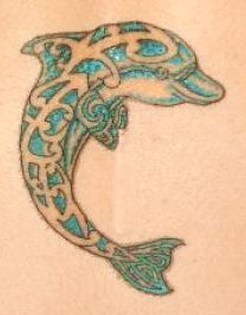 Celtic dolphin design tattoo