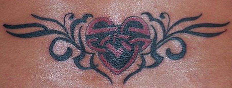 Celtic heart tattoo on lower back