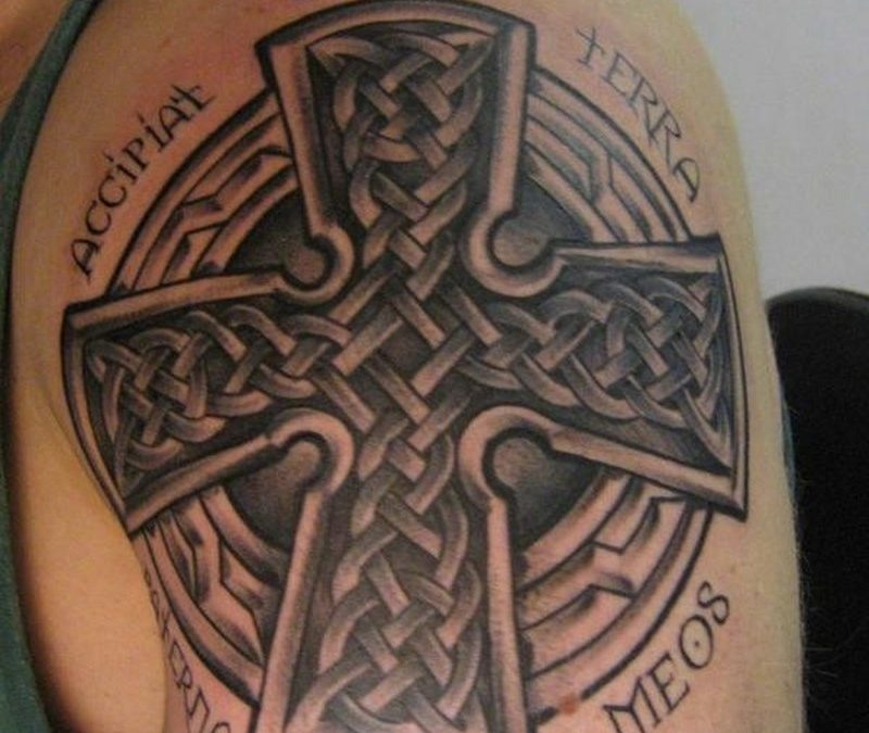Celtic iron cross with lettering tattoo on arm