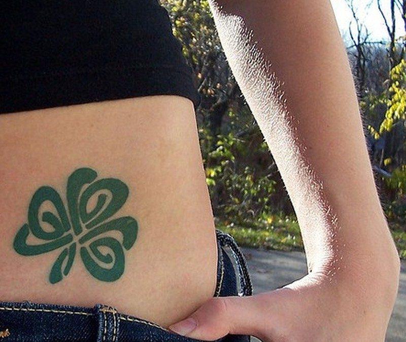 Celtic shamrock tattoo on hip