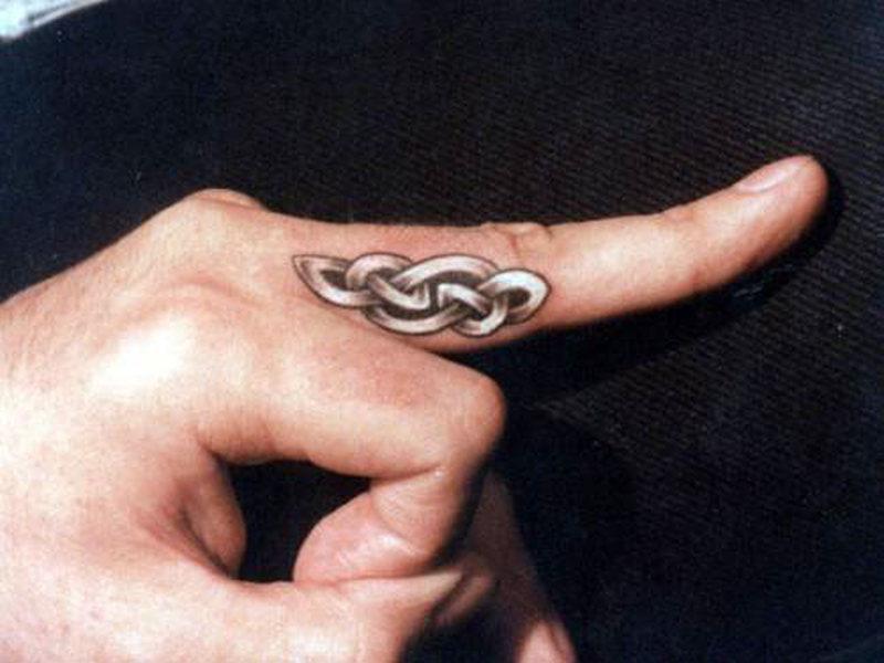 Celtic tattoo on finger