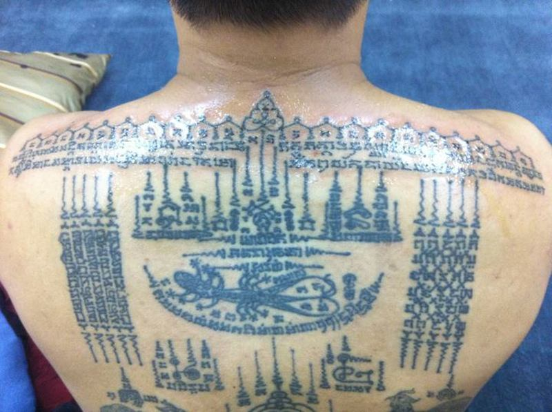 Charming religious buddhist tattoo on back
