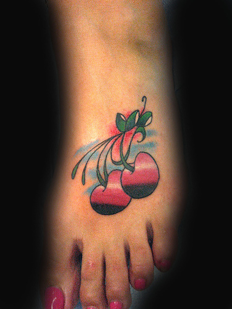 Cherries tattoo design on foot