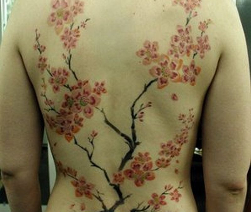 Cherry blossom tattoo on back for guys