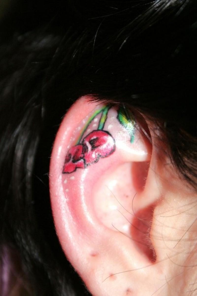 Cherry skull ear tattoo style