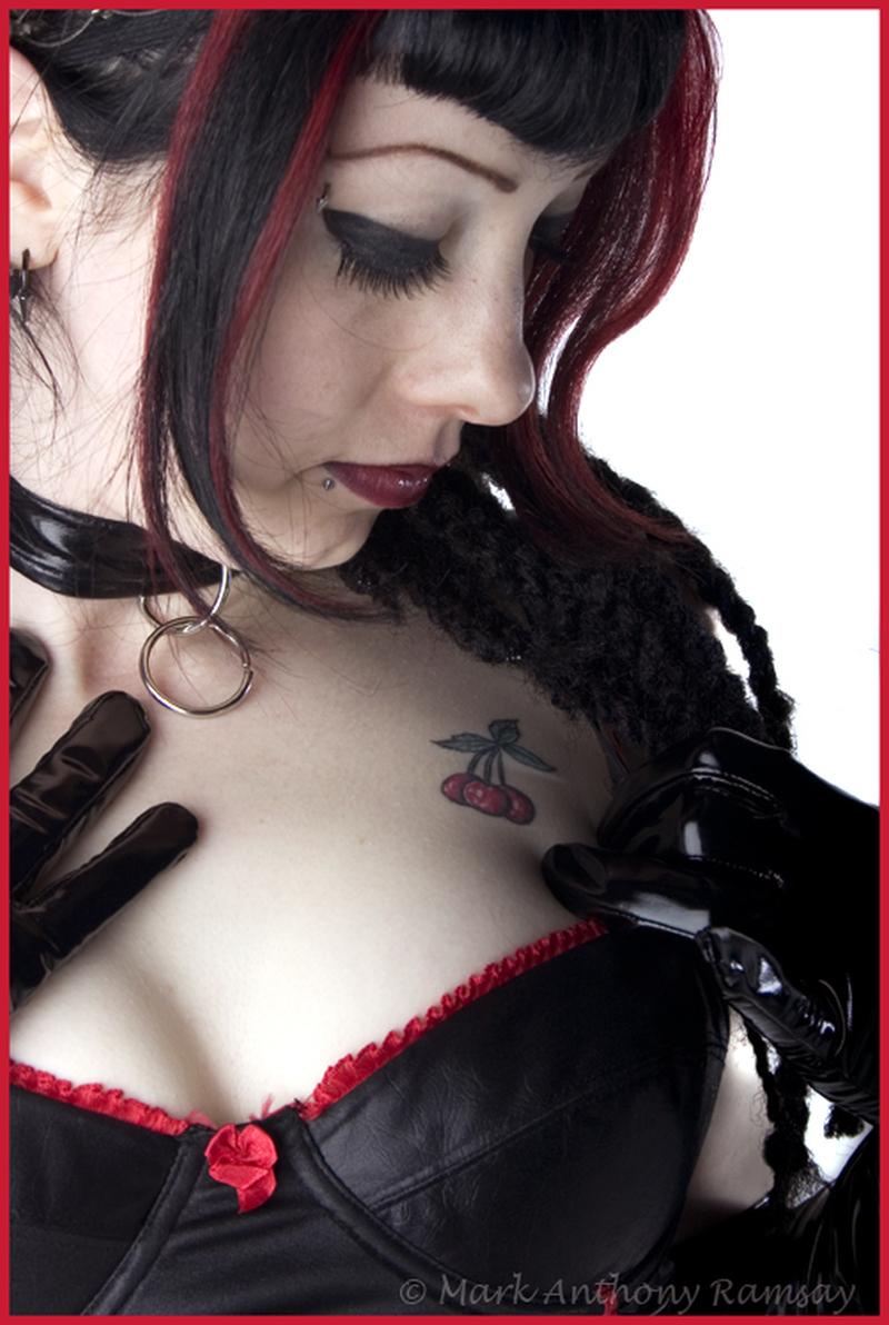 Cherry tattoo design on chest