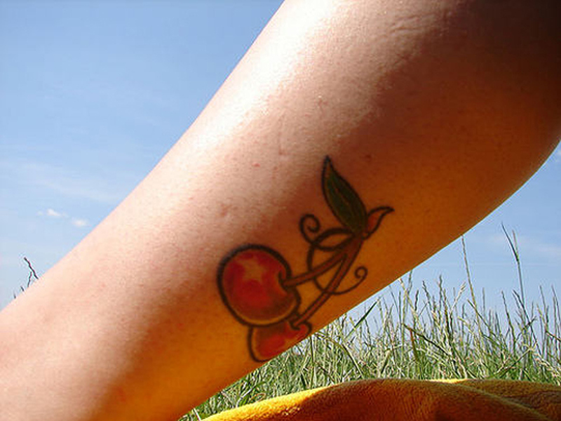 Cherry tattoo design on leg calf