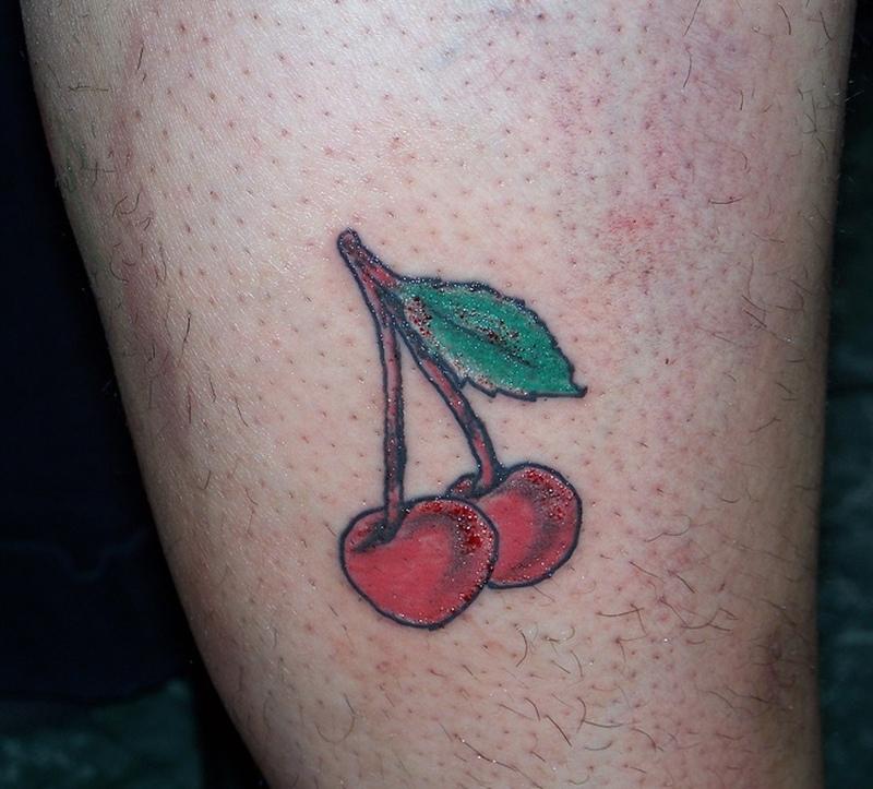 Cherry tattoo on thigh