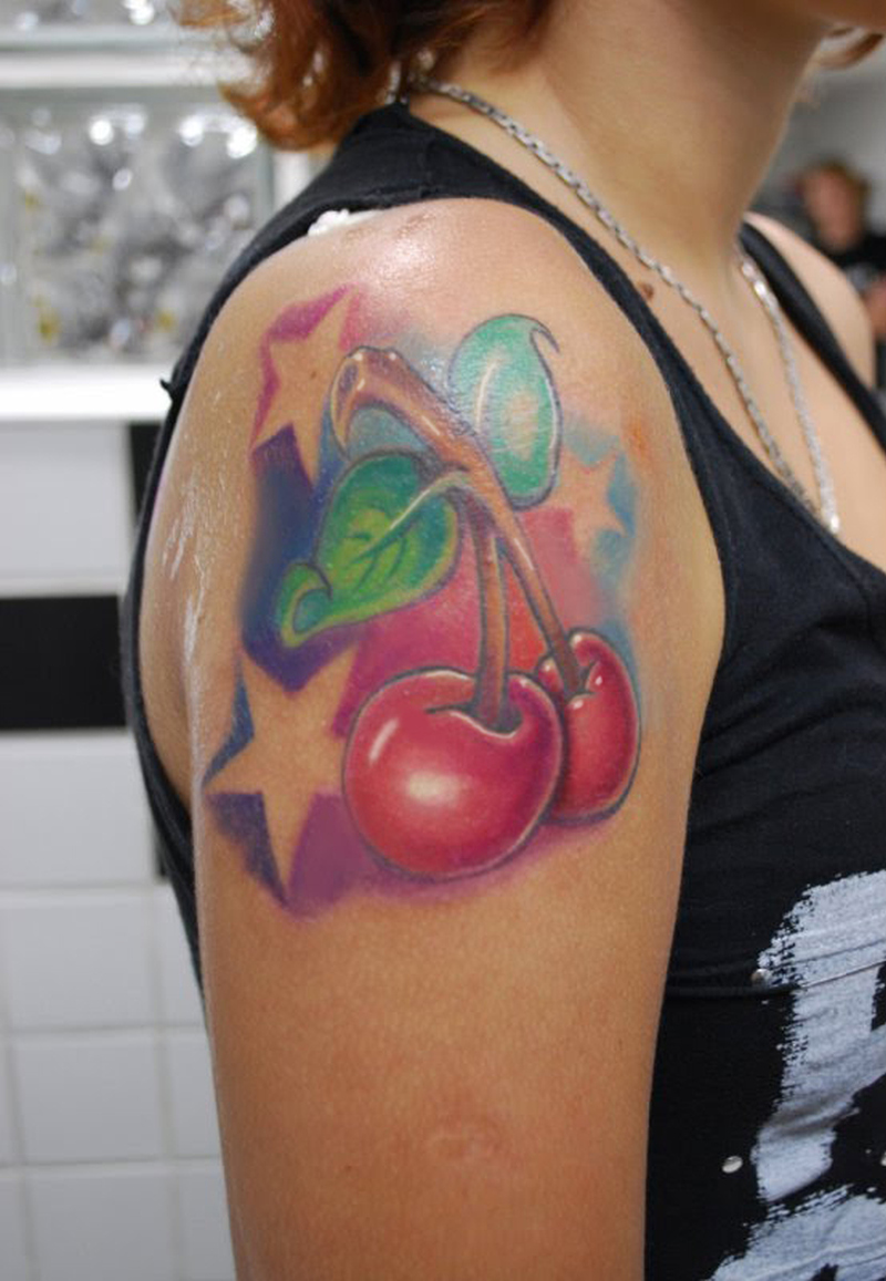 Cherry with stars tattoo design on shoulder