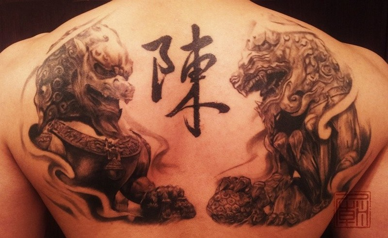 chinese guardian lions with chinese hieroglyphs tattoo on back tattoos book tattoos. Black Bedroom Furniture Sets. Home Design Ideas