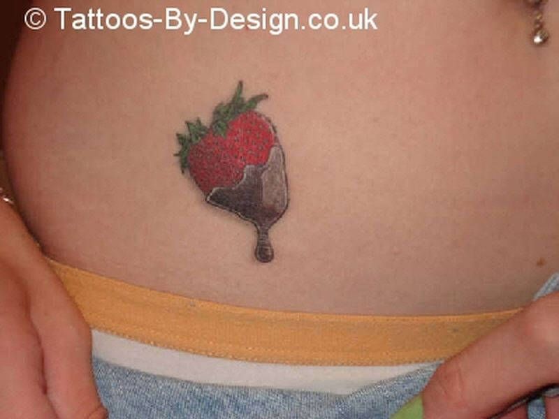 Chocolate covered strawberry tattoo on stomach