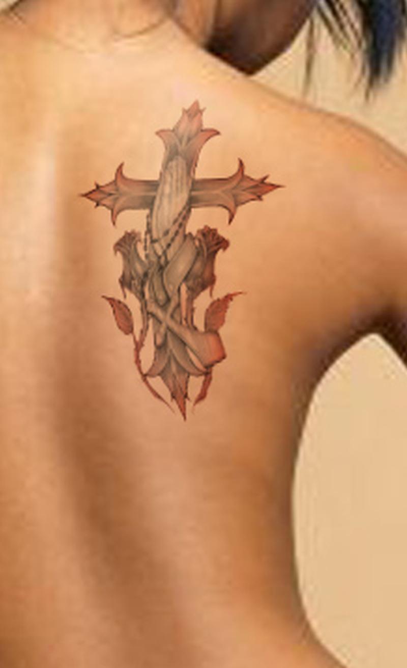 Christian tattoo on left shoulder blade