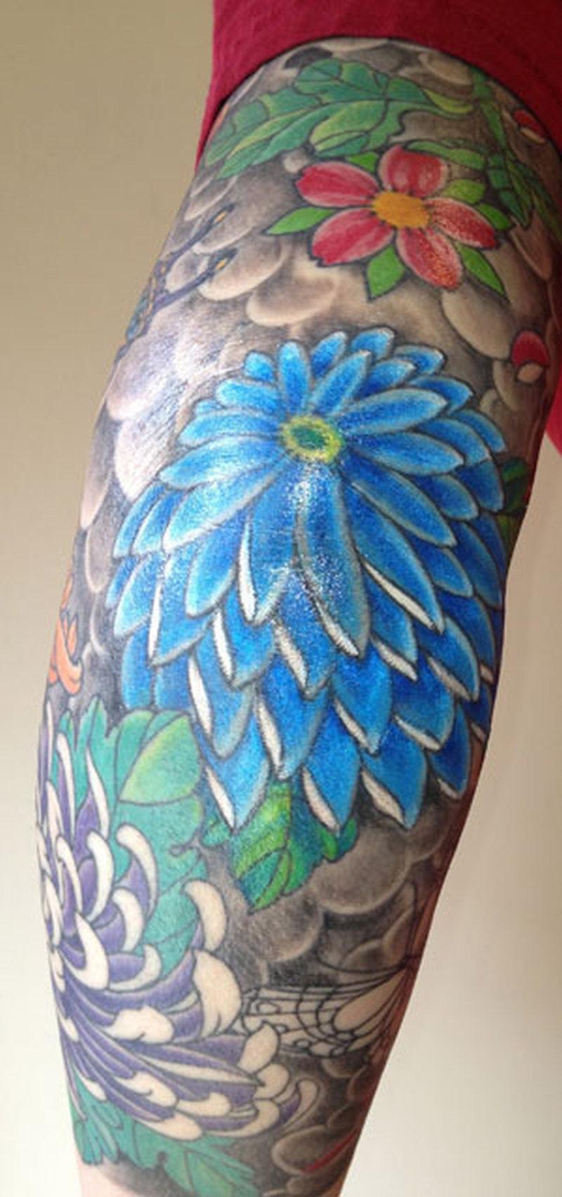 Chrysanthemum tattoo on bent elbow