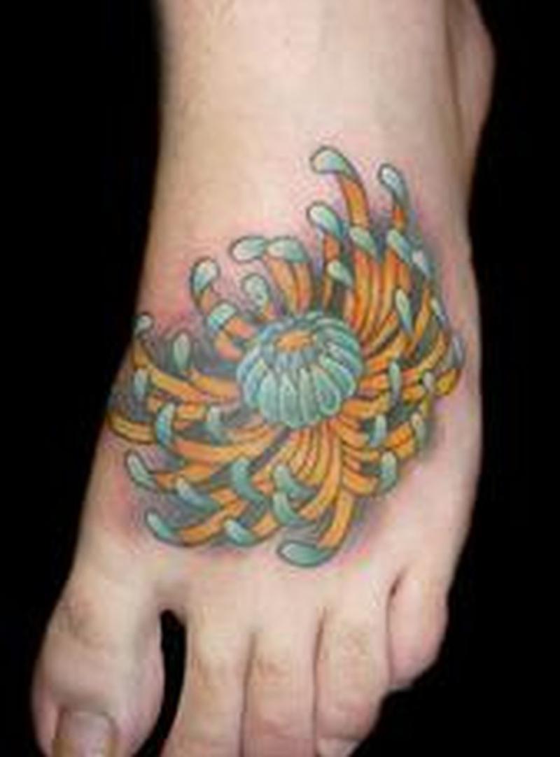 Chrysanthemum tattoo on foot