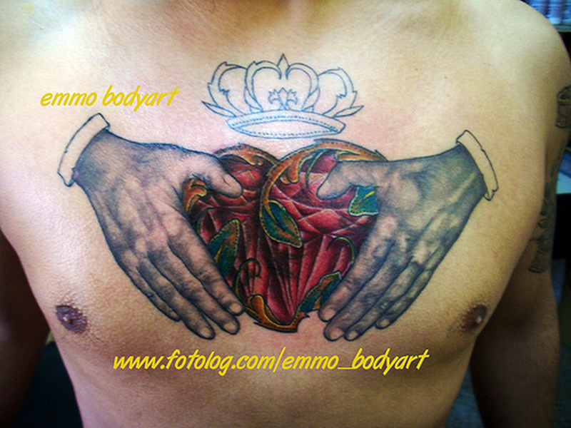 Claddagh tattoo on chest for men 3