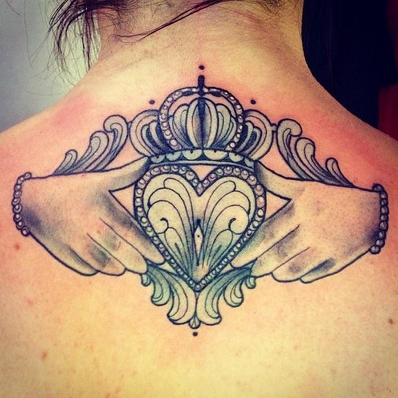 Claddagh tattoo on upper back 3
