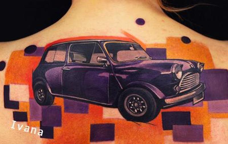 Classic mini car tattoo on upper back