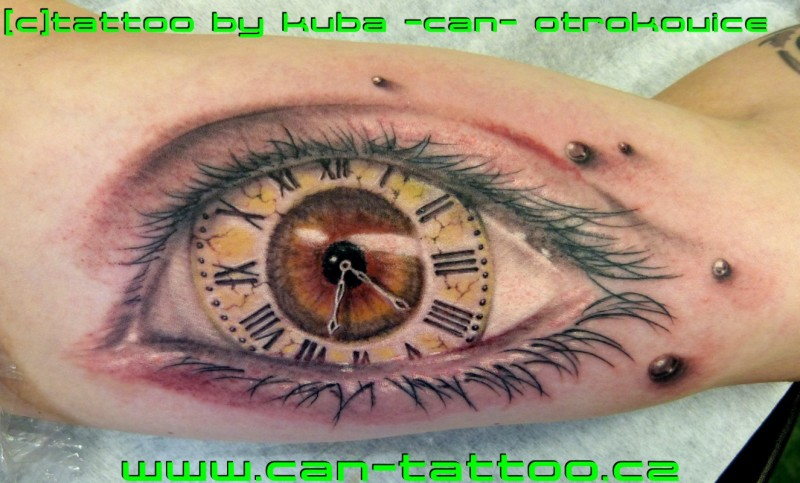 Clock eye tattoo on muscles