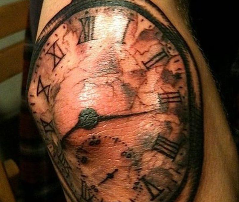 Clock tattoo on elbow