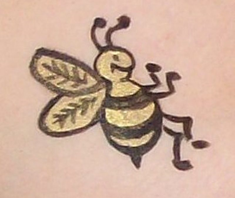 Closeup of bumblebee tattoo