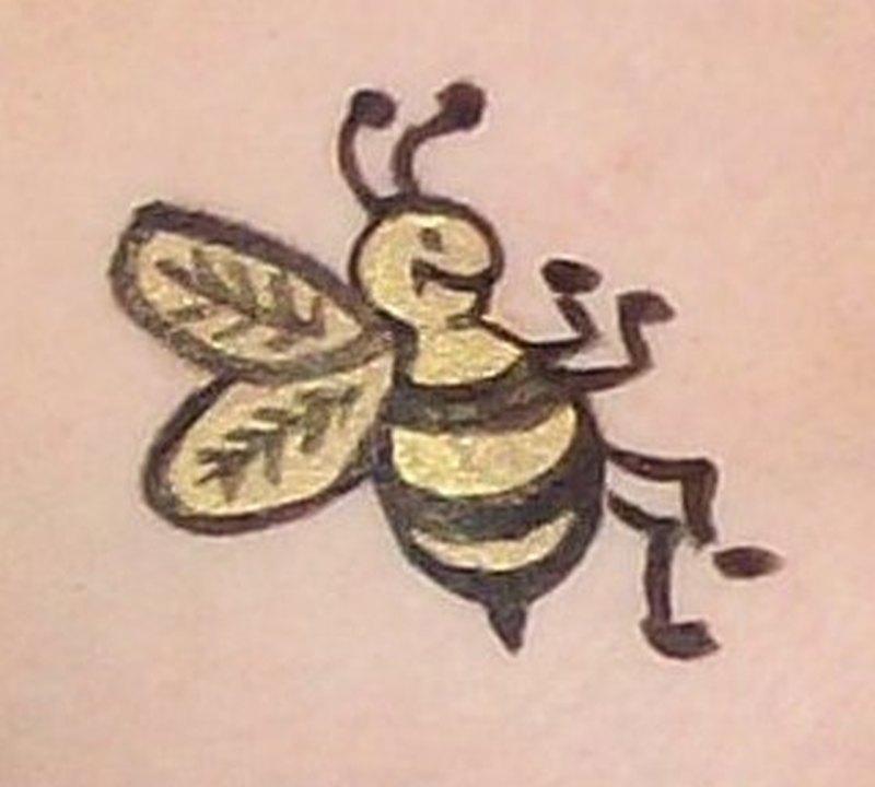 Closeup of bumblebee tattoo