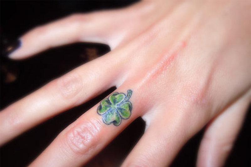 Clover tattoo on finger