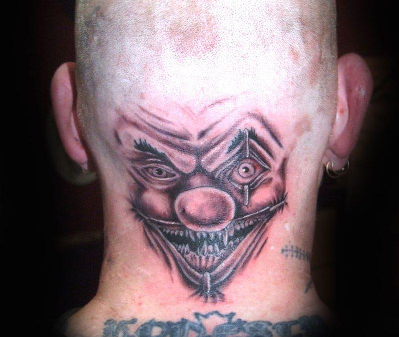 Clown tattoo on back head