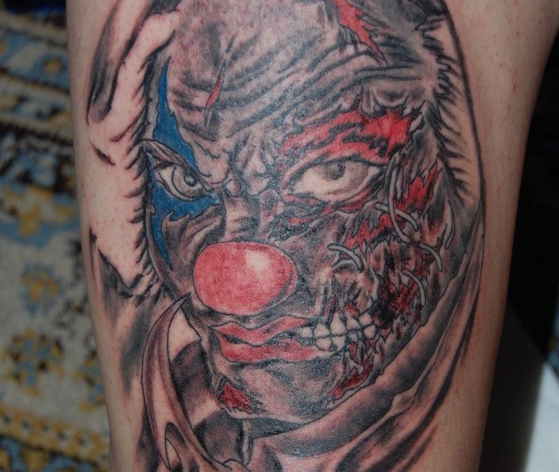 Clown tattoo on thigh