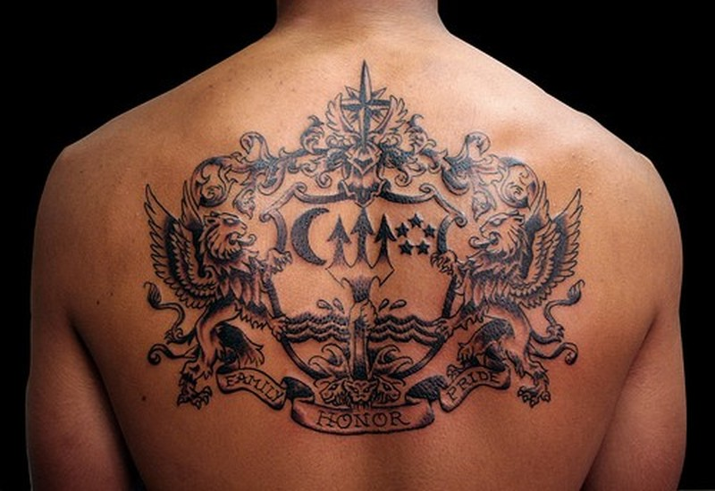 Coat of arms tattoo on upper back tattoo