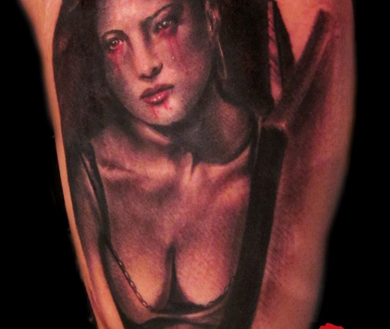 Coffin girl tattoo on muscles