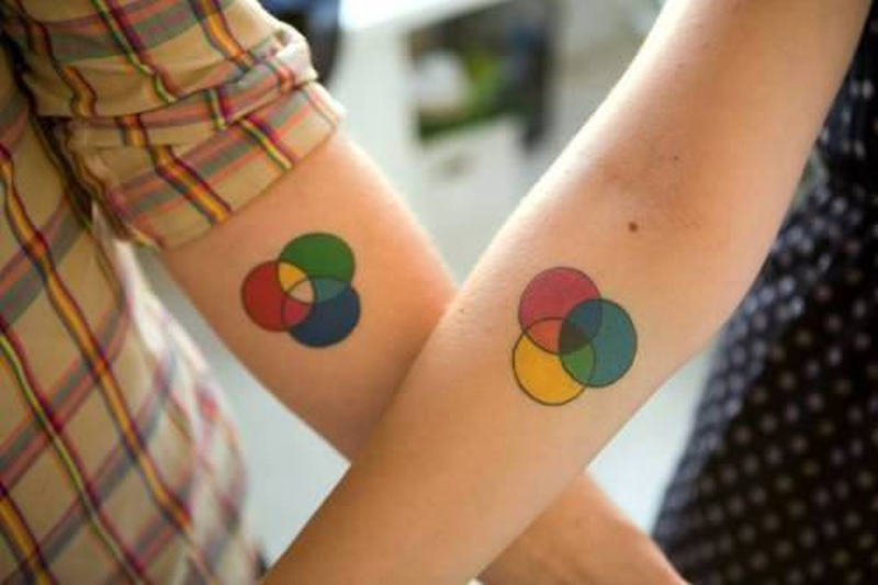 Color circles tattoo for couple