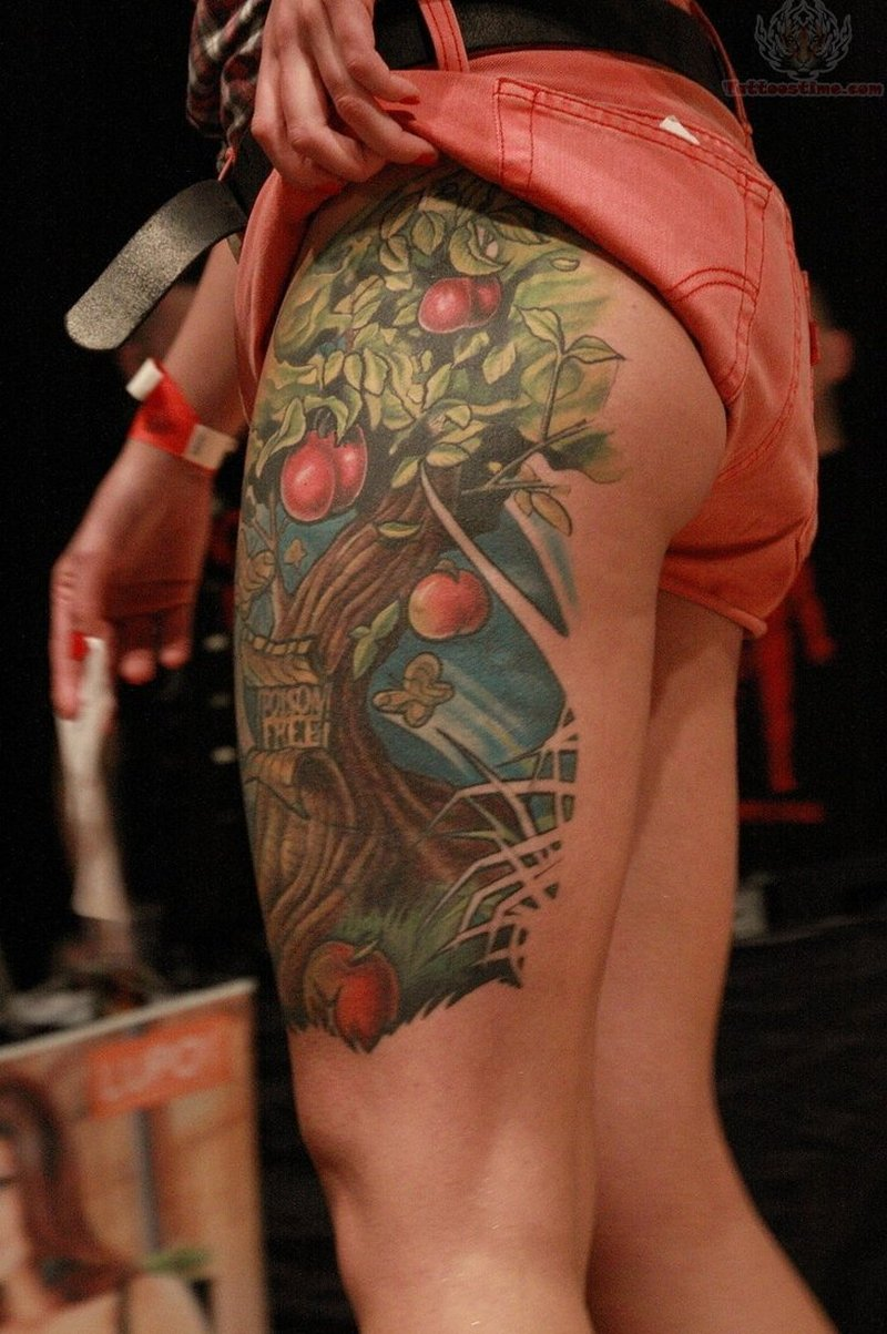 Color ink apple branch tattoo on thigh