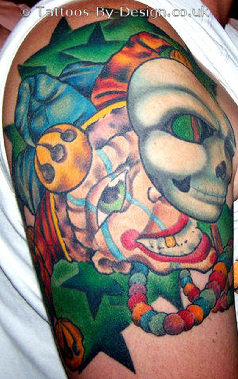 Color ink clown tattoo on shoulder