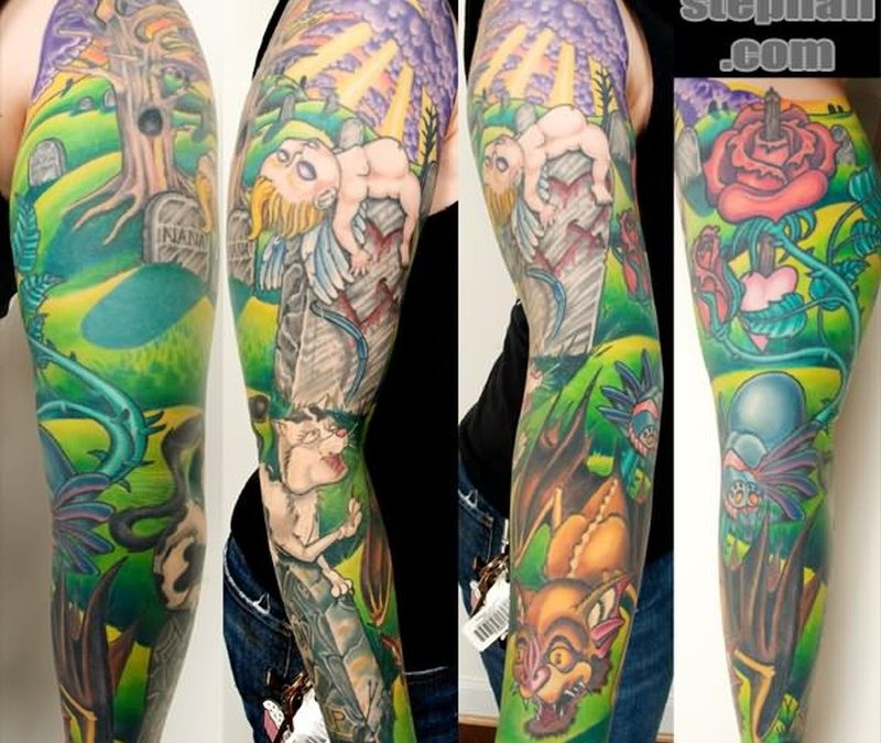 Color ink graveyard tattoo design on sleeve