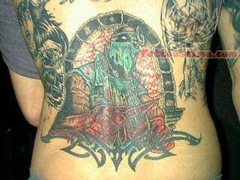 Colorful alien tattoo design on lower back
