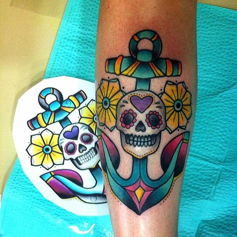 Colorful anchor tattoo with skull