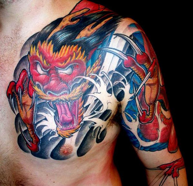 Colorful asian devil dragon tattoo on shoulder