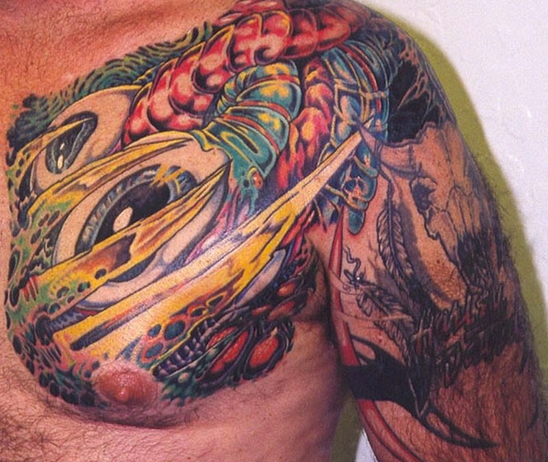 Colorful biomechanical tattoo on chest