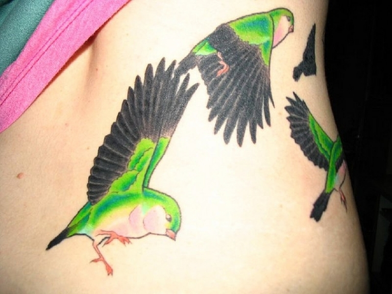 Colorful birds flying tattoo