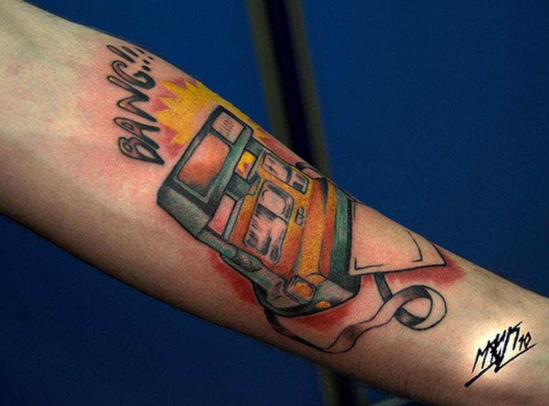 Colorful camera tattoo