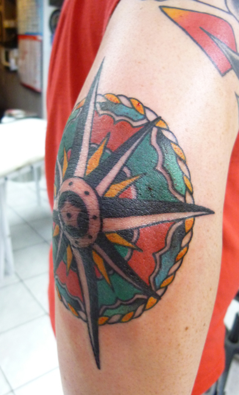 Colorful elbow compass tattoo design