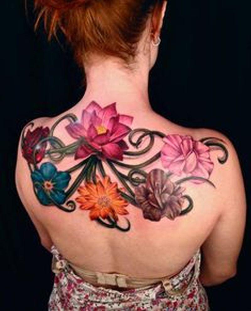 Colorful flowers feminine tattoo on back