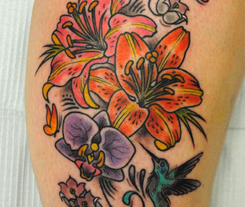 Colorful flowers n hummingbird tattoo design