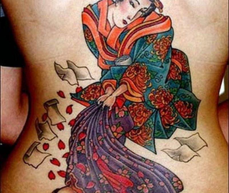 Colorful geisha tattoo on back of body