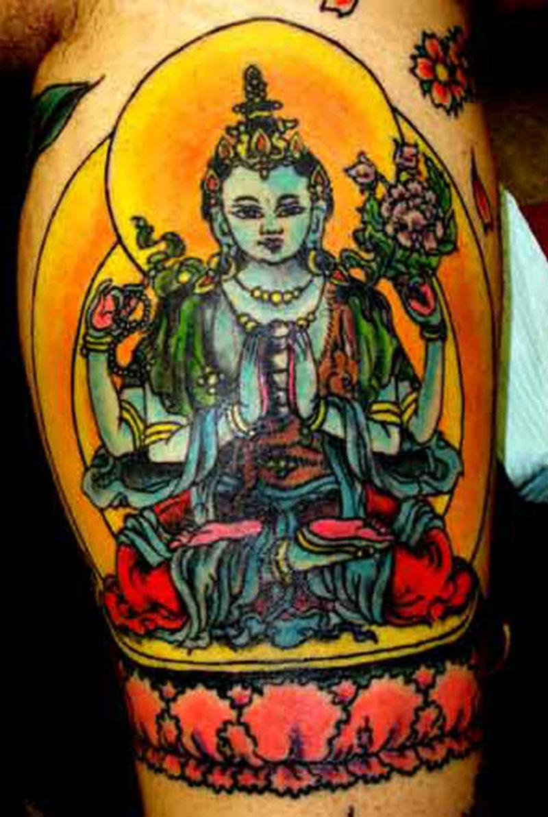Colorful tattoo of religious buddha