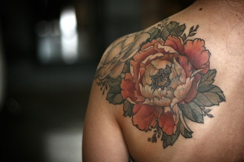 Coloured flowers tattoo on shoulder by Alice Kendall