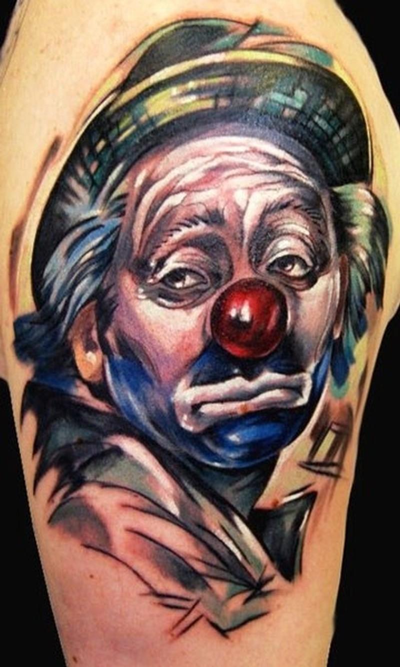 Coloured sad clown in a hat tattoo