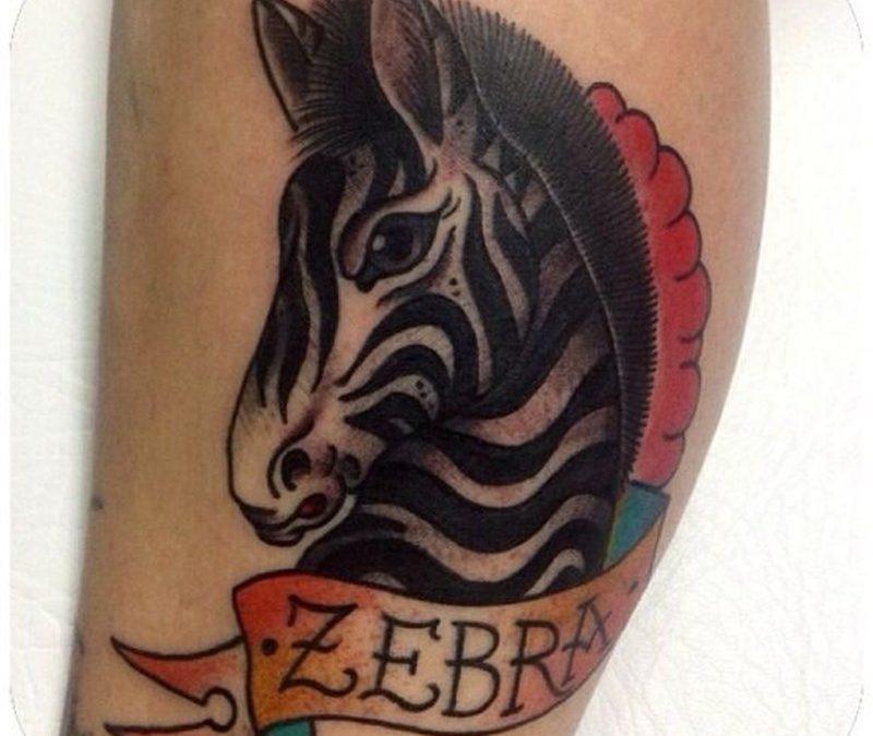 Coloured zebra head tattoo by Stephania Cuervo