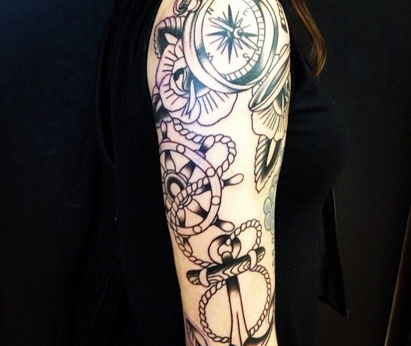 Compass ship wheel anchor tattoo on sleeve